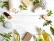 Aromatherapy supplies with basil leaves - 68548631