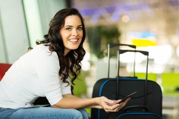 female traveller using tablet computer