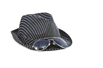 black fedora hat and sunglasses on white background