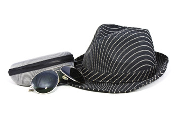 black fedora hat and sunglasses with case on white background