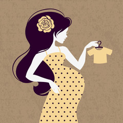 Vintage silhouette of pregnant woman with baby's loose jacket