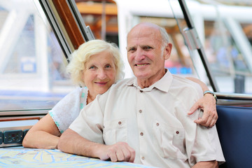 Senior couple enjoying boat trip on the canals of Amsterdam