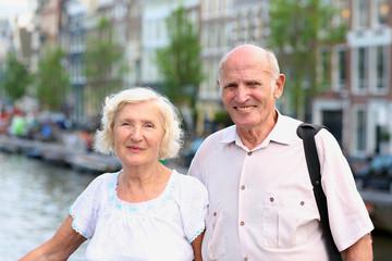Active senior couple enjoying canal views in Amsterdam