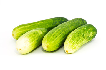 The green cucumbers on white background