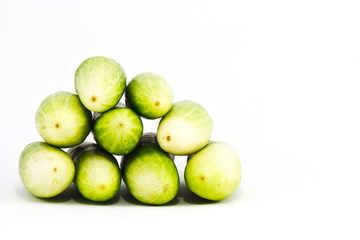 a pile of cucumber on white background