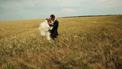 Wedding Couple in a Field