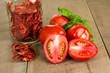 Fresh red paste tomatoes with basil and jar