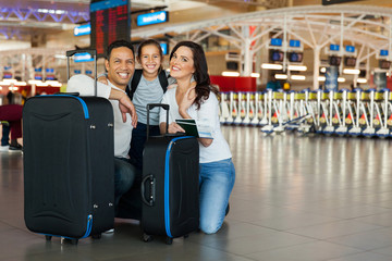 family with luggage bags at airport