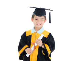 Asian boy in graduation gown and mortarboard