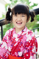 Little asian child in japanese traditional costume