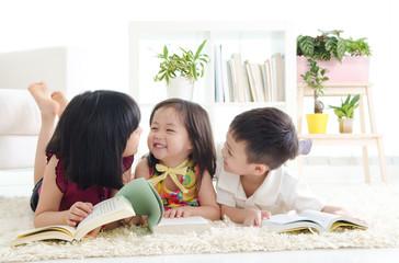 Asian kids lying on the floor