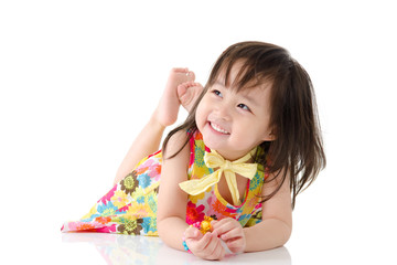 Lovely kid lying on the floor and smile