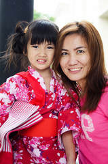 Little asian child in japanese traditional costume with your mot