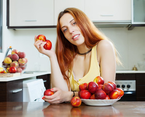 long-haired woman with nectarines