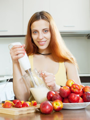 woman cooking beverages   from nectarines and milk