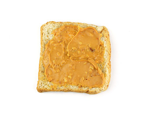 An open faced peanut butter sandwich on white bread