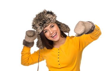 happy woman celebrating wearing winter hat.