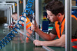 Factory workers and production process - 68555426