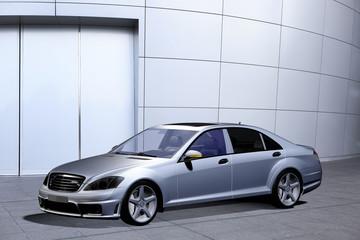 Luxuslimousine vor einer Metallfassade