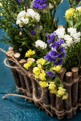 bouquet of wild flowers in a wooden rink