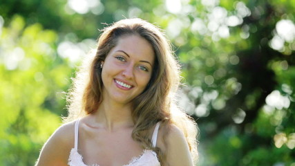 Outdoor portrait of happy long-haired  woman