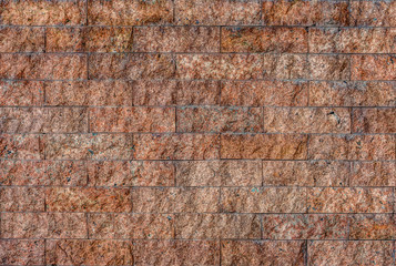 Natural granite stone tiles wall for background and texture