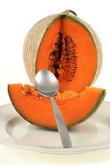 Un melon dans l'assiette