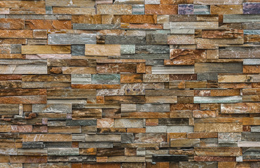 Natural colorful stone wall for background and texture