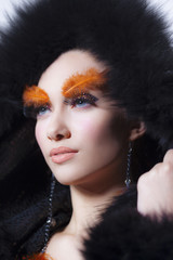 Gorgeous model with perfect art make up and long false eyebrows