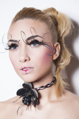 Gorgeous model with perfect art make up and long false eyelashes