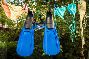 snorkeling equipment drying on clothesline