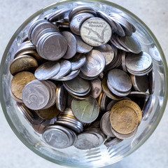 Cup full of italian coins