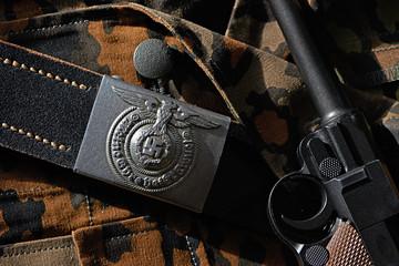 Belt Wehrmacht soldier and pistol Parabellum on camouflage unifo