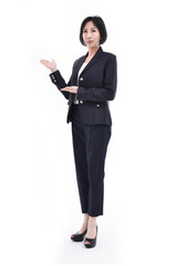 Middle aged corporate woman showing copy space