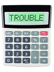 Calculator with TROUBLE on display on white background