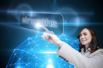 Businesswoman pointing to word strengths