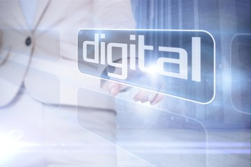 Businesswoman pointing to word digital