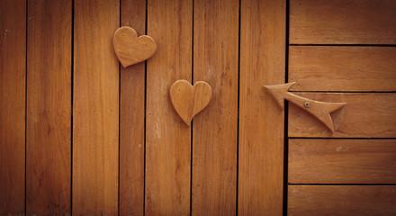 wood haert on wooden background