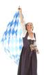 Alte Dame im Dirndl mit Fahne