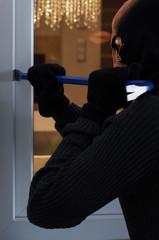 Burglar breaking into the house