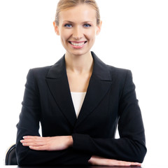 Smiling businesswoman at workplace, isolated