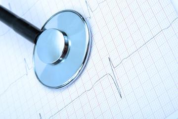 Cardiogram and stethoscope, on blue tone