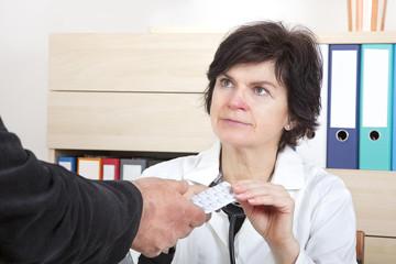 Doctor explaining patient's tablets