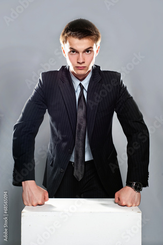 Young and seriously businessman Poster