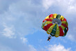 Parasailing against cloudy sky - 68566422