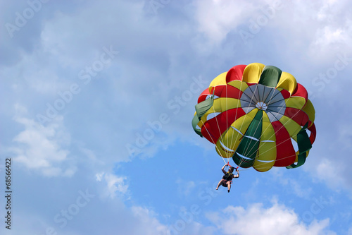 Fotobehang Luchtsport Parasailing against cloudy sky