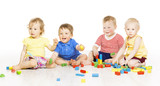 Fototapety Children playing toy blocks. Baby Kids isolated white background