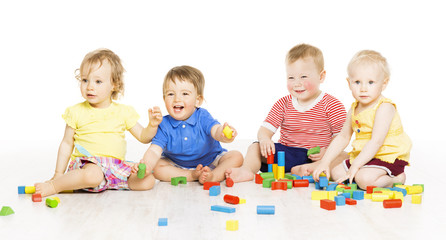 Children playing toy blocks. Baby Kids isolated white background