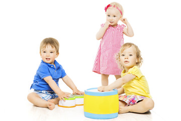 Children playing toys. Small Kids isolated white background