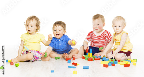 Children playing toy blocks. Baby Kids isolated white background - 68566879